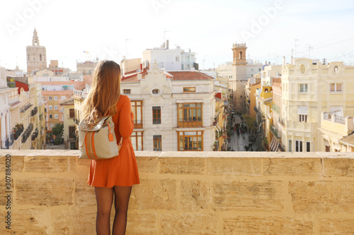 Visiting Valencia. Back view of young traveler woman enjoying cityscape of Valencia, Spain.