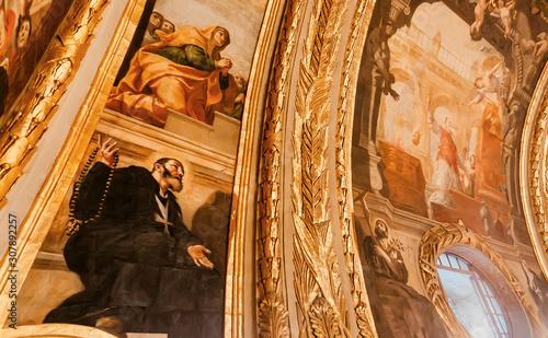 Valokuva Priest on old fresco of the 16th century St John's Cathedral, historical Roman Catholic church