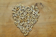 Heart Of Wooden Letters On A W...