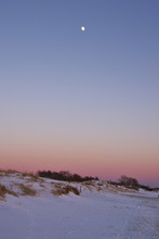 Moon Over The Frozen And Snowy...