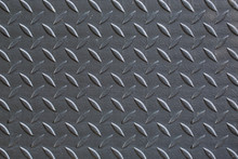 Industrial Wallpaper Of Functional Anti-slip Metal Tread Plate In Grey Silver Color And Rough Raised Surface Pattern. Creative Lighting Macro Photography Of Construction For Catwalks, Stairs, Walkway.