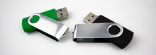 USB Devices For Data Storage Made Of Plastic And Metal, Open, On White Background