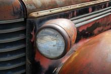 Headlight Of An Old Rusty Car.