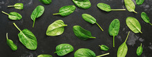 Fresh Spinach Leaves On A Dark Stone Background, Border. Spinach Pattern, Banner. View From Above