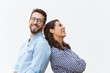 Joyful carefree couple leaning on each other, chatting and laughing at joke. Young woman in casual and man in glasses in glasses posing isolated over white background. Sweet couple concept