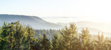 Fototapeta  - Amazing panorama background banner long from a fog landscape in the morning in black forest