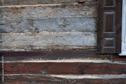 old weathered wooden of a rural cottage with a shutter. Plenty of copy space