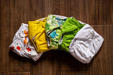 Stack Of Colorful Cloth Diapers For Baby