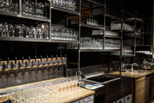 Wine And Beer Glass Shelves In A Restaurant Or Pub