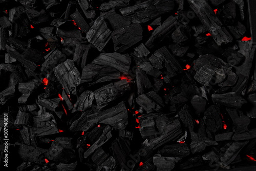 Charcoal background illuminated with red light underneath Canvas Print