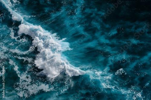 Fototapeta Aerial view to waves in ocean Splashing Waves. Blue clean wavy sea water. Bali, Indonesia. obraz