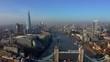 Establishing Aerial View of the Tower Bridge, Shard Skyscraper and London Skyline