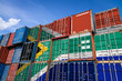 canvas print picture - The national flag of South African Republic. on a large number of metal containers for storing goods stacked in rows on top of each other. Conception of storage of goods by importers, exporters
