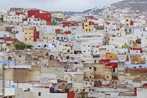 View of the colorful old buildings of Tetouan Medina quarter in Northern Morocco. A medina is typically walled, with many narrow and maze-like streets and often contain historical houses and places.