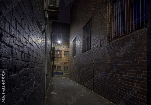 Spooky alley at night Canvas Print