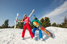 Happy Friends Having Fun Playing In Snow. Ski And Snowboard Sunny Holiday