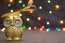 Christmas Gold Owl Decoration On Garland Background