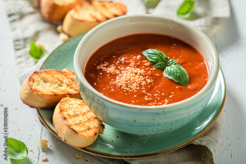 Fototapeta Tasty and creamy tomato soup made of fresh tomatoes obraz