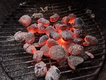 Close Up Glowing Charcoal Briquettes On Grill Grate