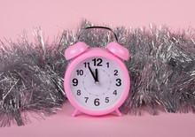 Pink Clock Showing Almost Midnight As A New Year Concept