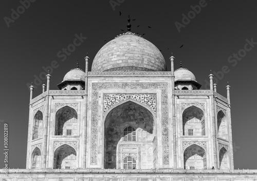 Fototapeta Agra, Uttar Pradesh/India - March 21 2019: A black and white portrait of the Taj Mahal as seen from the promenade surrounding it