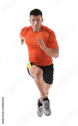 obraz PCV Athletic young man running on white background