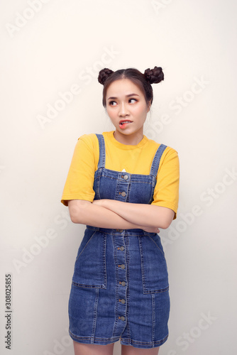 Photo Portrait of grimacing funny capricious young woman model with bun hairstyle isol