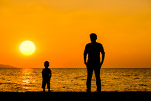 Silhouette Father And Son Stan...