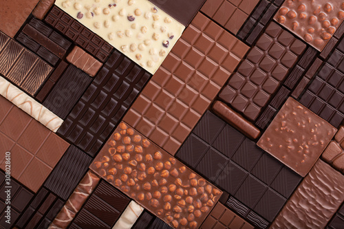 Fotomural varied chocolate background. milk and dark cocoa bar, top view.