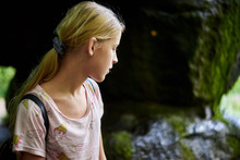 Teen Girl Near A Stone Cave