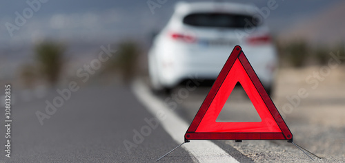 Broken down car with warning triangle behind it waiting for assistance to arrive Canvas Print