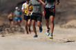 canvas print picture - Runners running shoes on trail run. Ultra running athletes legs close up on running in rock path trail
