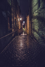 One Of Edinburgh Close Street  By Night Off The Royal Mile.
