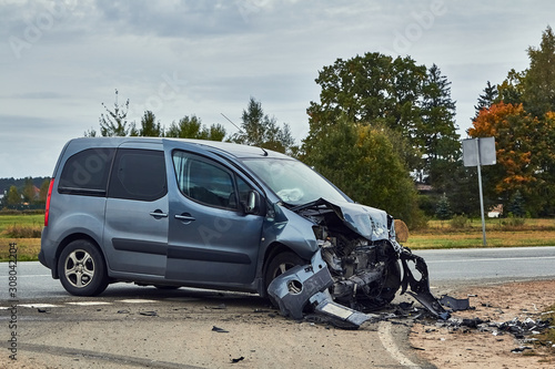 Damaged car after accident on a road Canvas Print