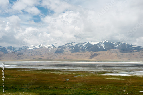 Fototapeta Ladakh, India - Jul 12 2019 - Tso Kar Lake in Ladakh, Jammu and Kashmir, India.  is a fluctuating salt lake situated in the Rupshu Plateau and valley in the southern part of Ladakh in India. obraz na płótnie