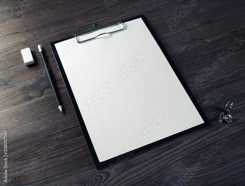 Fototapeta Blank branding stationery set. Clipboard with blank letterhead, pencil and eraser on wood table background. obraz