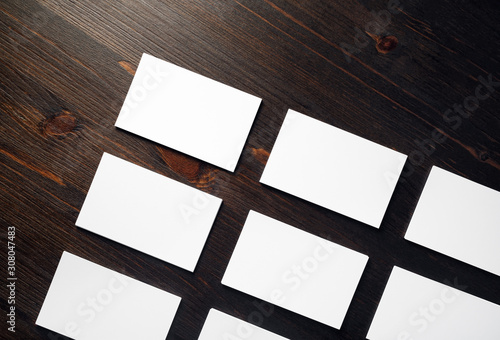 Fotografía  Photo of blank white business cards mock-up on wooden background