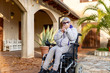 canvas print picture - older woman constipated in a wheelchair in the garden