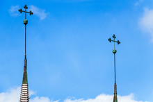 Church Spire With Tree Clover At A Blue Sky