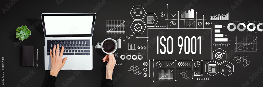 ISO 9001 concept with person using a laptop computer