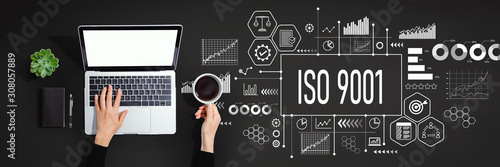Photo ISO 9001 concept with person using a laptop computer