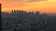TOKYO, JAPAN - DECEMBER 2019 : Aerial high angle sunset view of CITYSCAPE of TOKYO and Mount Fuji. View of office buildings and business district around Shinjuku city. Time lapse shot sunset to night.