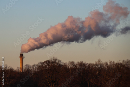 Smoke / steam plum riasing from a factory smoke stack Fototapete