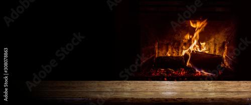 Obraz Empty table with burning fire - fototapety do salonu