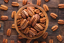 Pecan Nuts Peeled In Wooden Bowl, Top View.