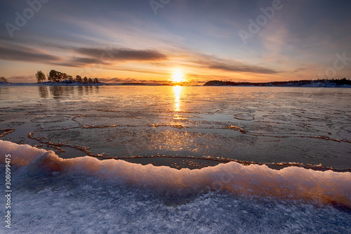 Fotografia, Obraz The first ice  off the coast on the water in Lake Ladoga at dawn with fresh snow