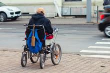 A Homeless Man In A Wheelchair