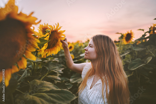 Woman in sunflowers field harmony with nature travel healthy lifestyle outdoor agriculture organic harvest ecology concept