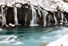 Hraunfossar Is A Series Of Wat...