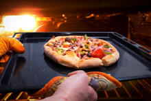 Woman Took Out Ready Pizza From Oven. Pizza Baked In Oven. Cooking Pizza At Home